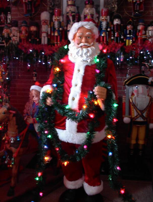 Life size animated foot santa in tangled lights with