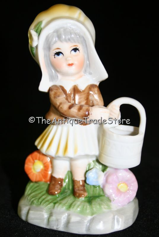 Vintage ceramic figurine Dutch style girl with paint bucket