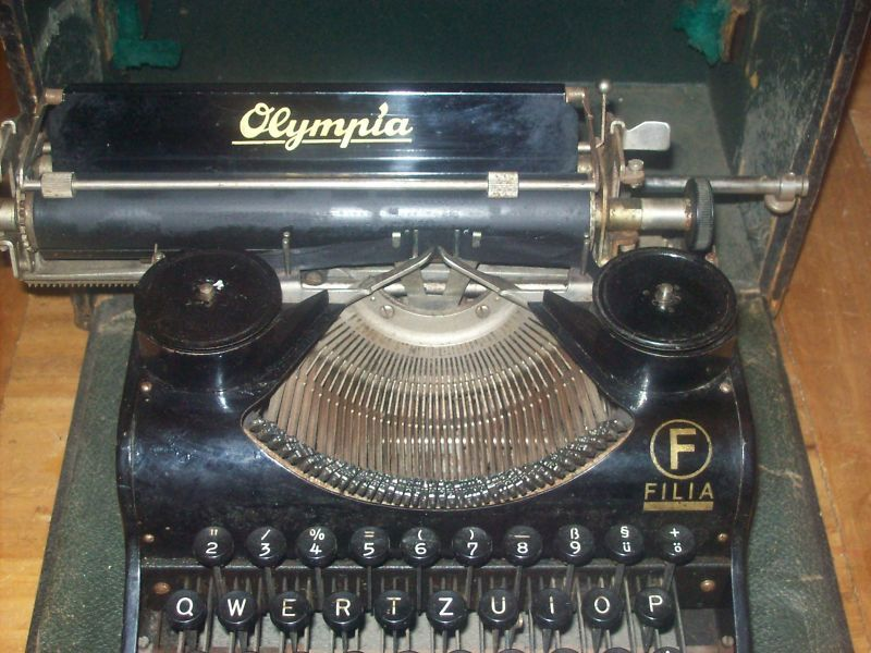 Antique Olympia Filia Typewriter Close up Logo
