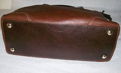 Brass feet on bottom of Coach leather purse