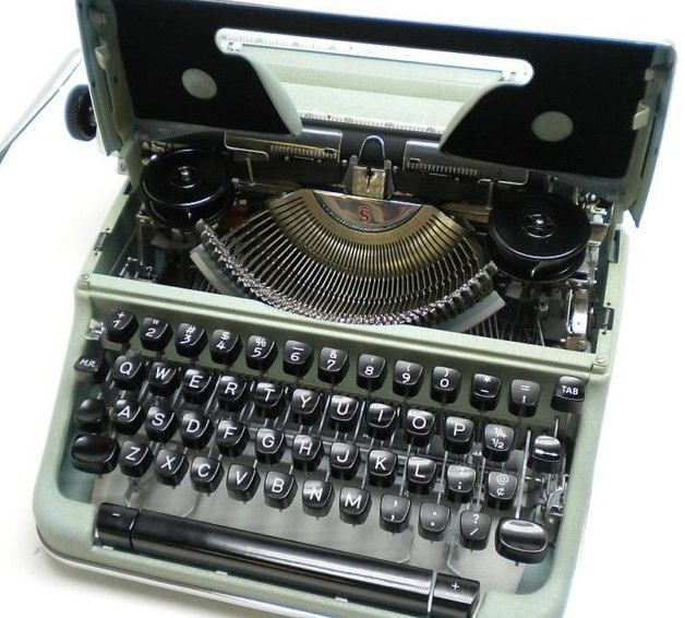 Olympia SM4 Script/Cursive Portable Manual Typewriter