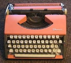 Pink Olympia Cursive SF Deluxe Typewriter