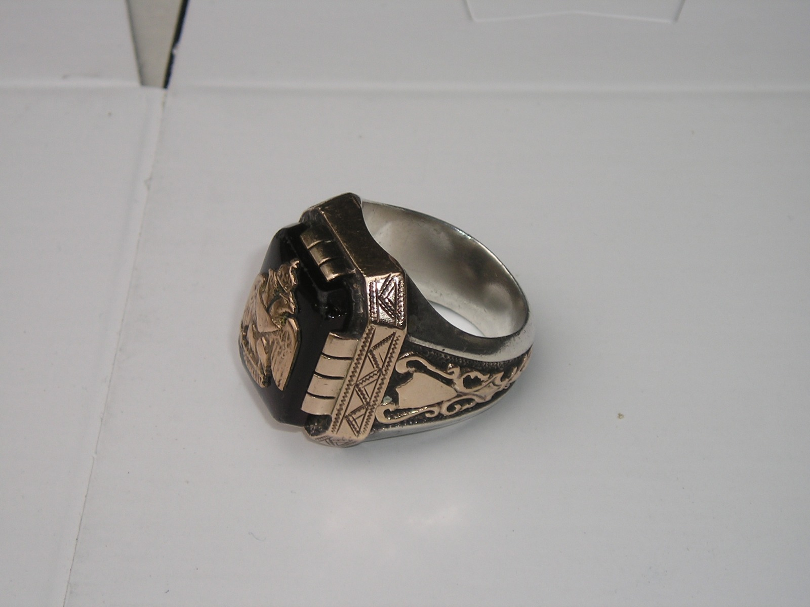 Can someone help identify this symbol masonic sco the ebay the ring appears to be sterling and 10k gold but is not marked i am assuming its oldything would be greatly appreciated biocorpaavc