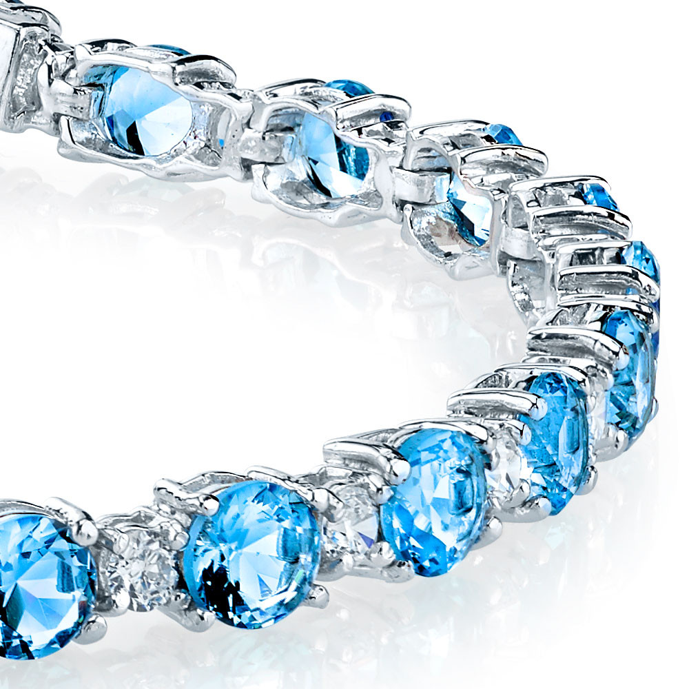 Sterling Silver Diamond And Blue Topaz Tennis Bracelet