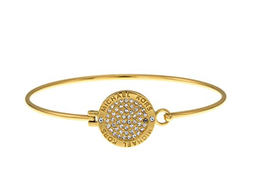 a4aa1b7861e Michael Kors crystal pave bangle bracelet styled in stainless steel.  Diameter: 2.5